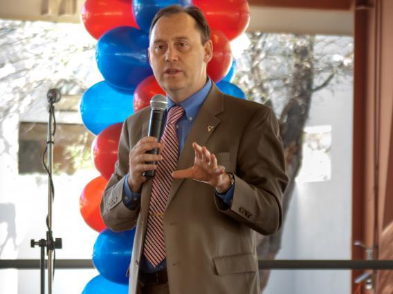 Image of Vice President Burgess speaking at school dedication.