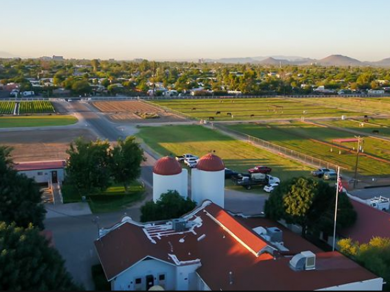 Bird's eye view of Campus Agricultural Center with historic buildings in foreground