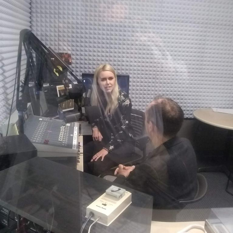 KAMP programming director Alli Gilbreath and Shane Burgess on the air.
