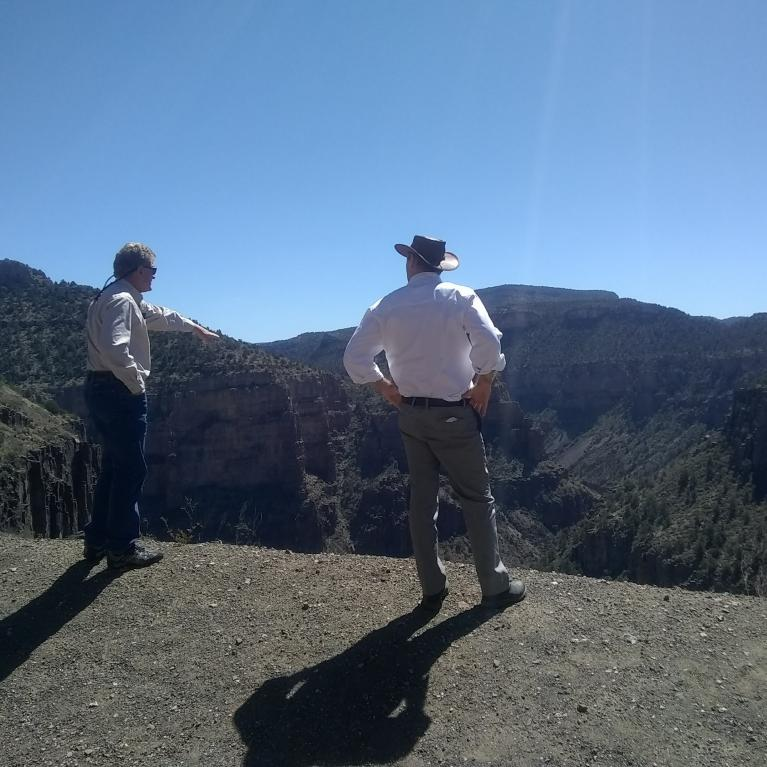 Associate Director of Tribal Extension Trent Teegerstrom (left) and Shane Burgess look out over the Salt River Canyon on an overlook north of Globe during their recent tour of Tribal Extension Offices.