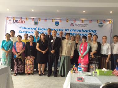 Group of men and women celebrating opening of international workshop at Yangon University.